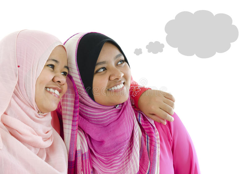 Thought Bubble. Two Muslim women having thought together, looking at side royalty free stock images