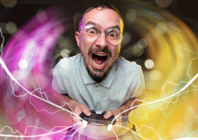 Enthusiastic gamer. Joyful young man holding a video game controller stock photo