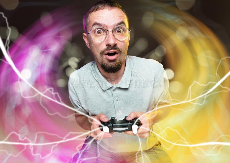 Enthusiastic gamer. Joyful young man holding a video game controller stock images