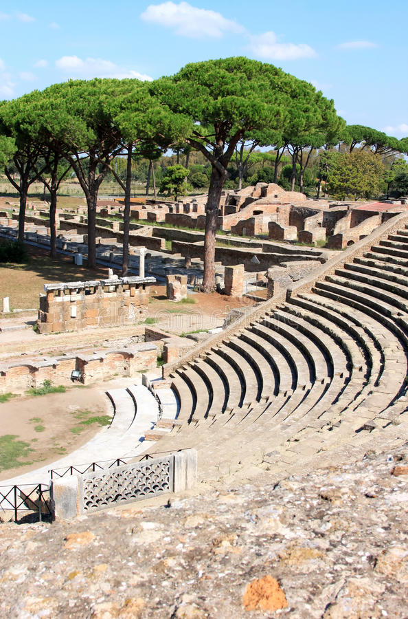 Ruins of Amfitheatre and Fire Brigade, Ostia Antica, Italy. It is thought Ostia Antica, at the mouth of the river Tiber, was founded in about 335 BC as one of stock images