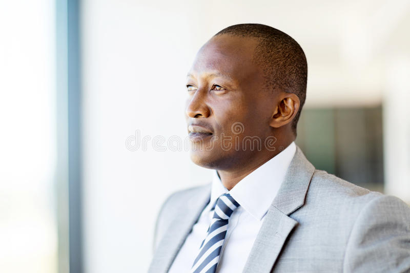 Thoughtful african businessman. In office royalty free stock photo