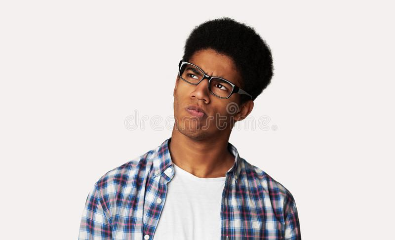 Thoughtful Afro Guy Thinking and Looking Aside stock photography