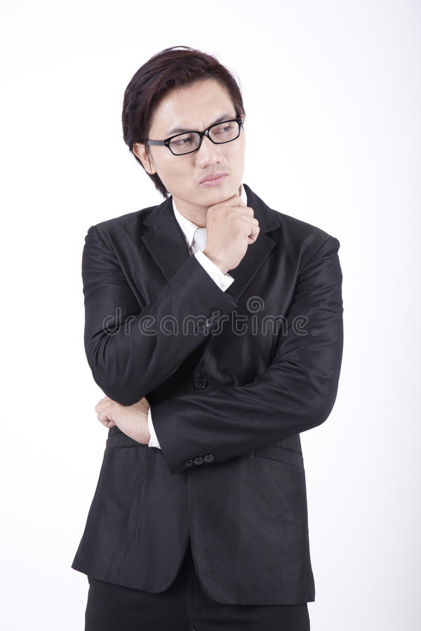 Thoughtful Asian Businessman shot in studio stock photography
