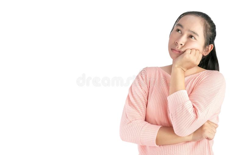 Thoughtful of Asian woman face holding hand near the face and looking seriously up, standing over white background with space for royalty free stock images