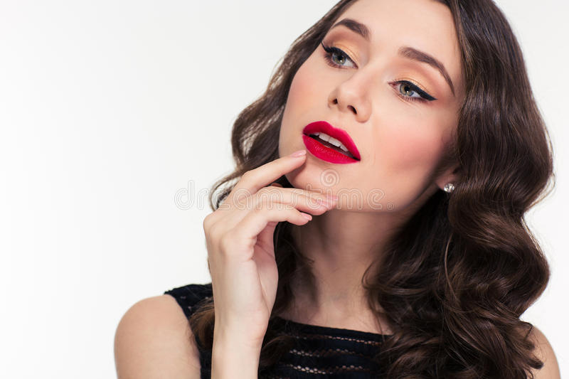 Thoughtful attractive curly woman with bright makeup in retro style royalty free stock images