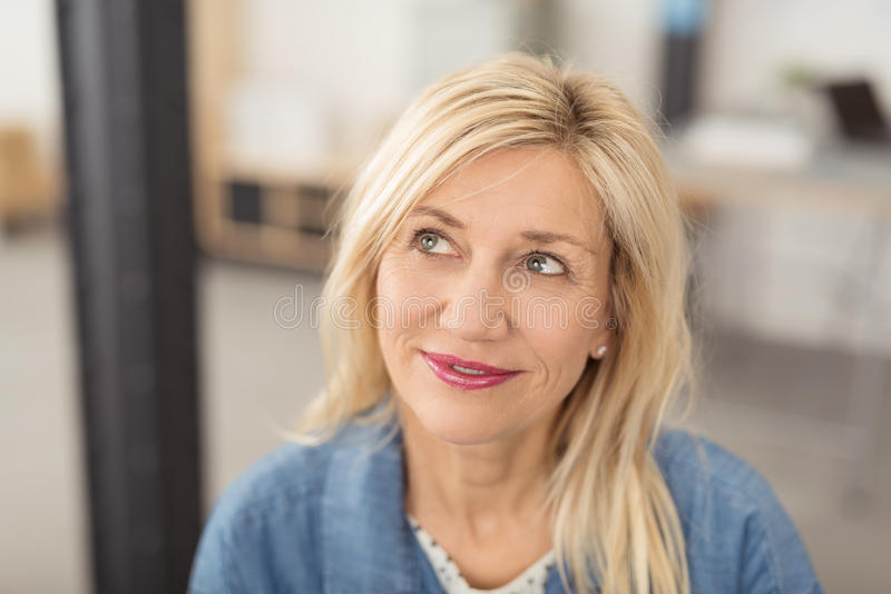 Thoughtful attractive middle-aged woman stock photos
