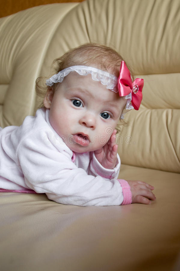 Thoughtful baby. Portrait of a baby in a pensive pose royalty free stock photos