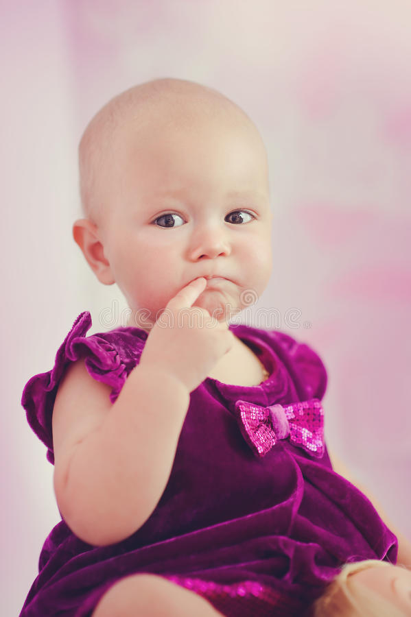 Thoughtful baby girl royalty free stock images