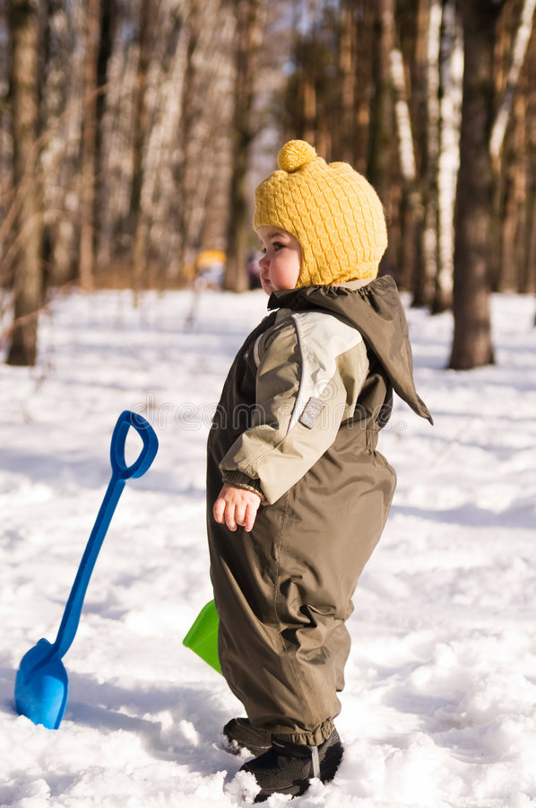 Download Thoughtful Baby With Shovels Stock Photo - Image: 6220462