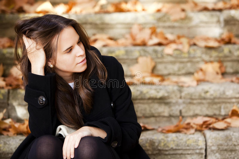 Thoughtful beautiful girl stock photo