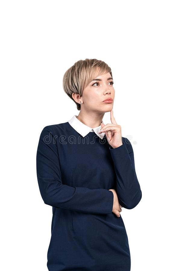 Thoughtful blonde businesswoman, isolated portrait stock photography