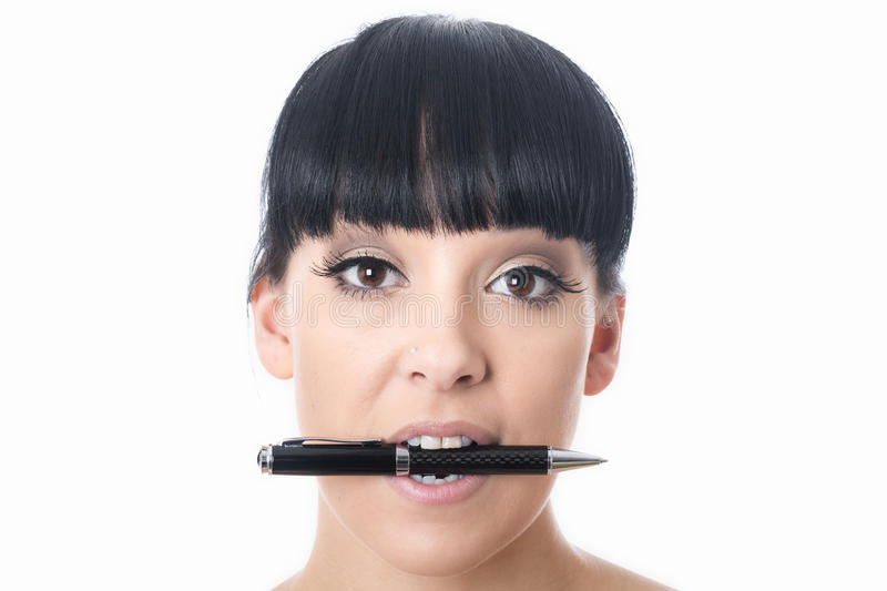 Thoughtful Bored Confused Attractive Young Woman with Pen in Mouth. Thoughtful bored confused attractive Young Woman with black hair or hispanic or european stock photos