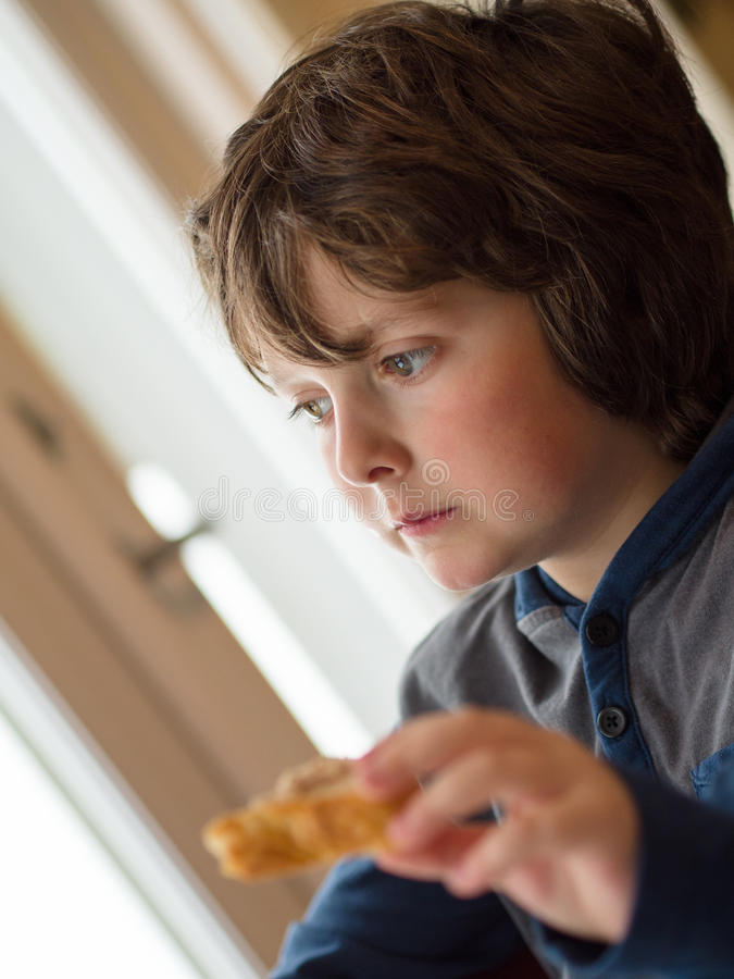 Boy eating a toast royalty free stock photo