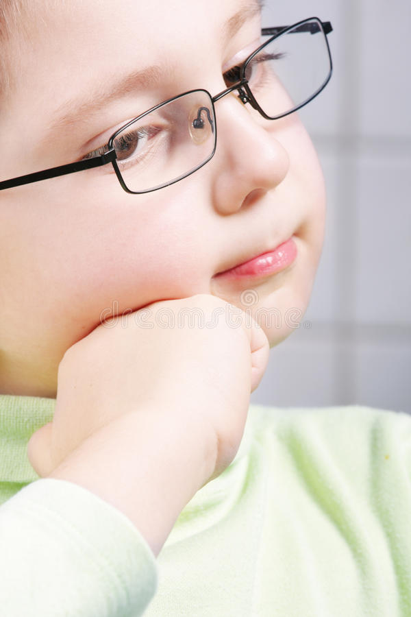 Download Thoughtful Boy Leaning On Fist Stock Image - Image: 12485295