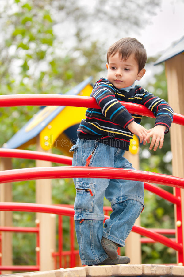 Free Thoughtful Boy On The Playground Stock Image - 21522491