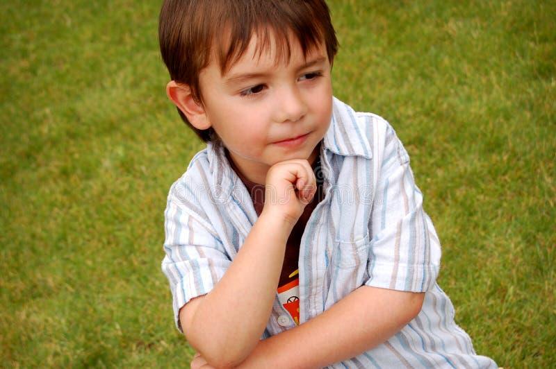 Thoughtful boy outdoors stock photos
