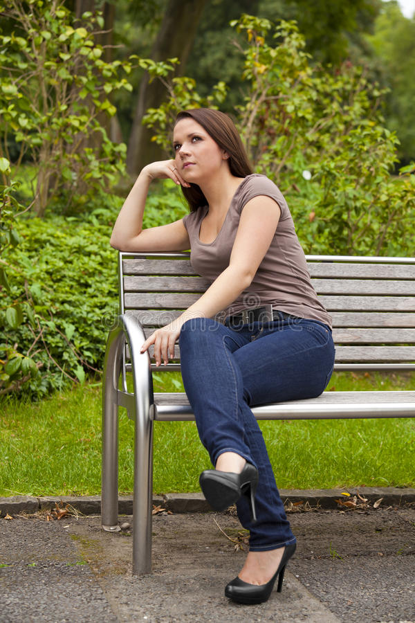 Download Thoughtful brunette woman stock image. Image of jeans - 21203851