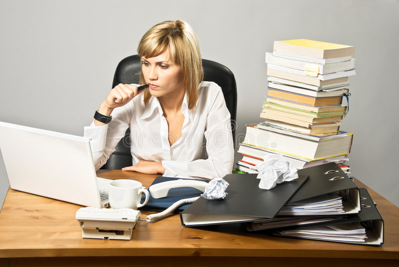 Thoughtful Business Lady at Desk stock images