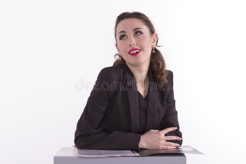 Thoughtful business lady looking away stock photography