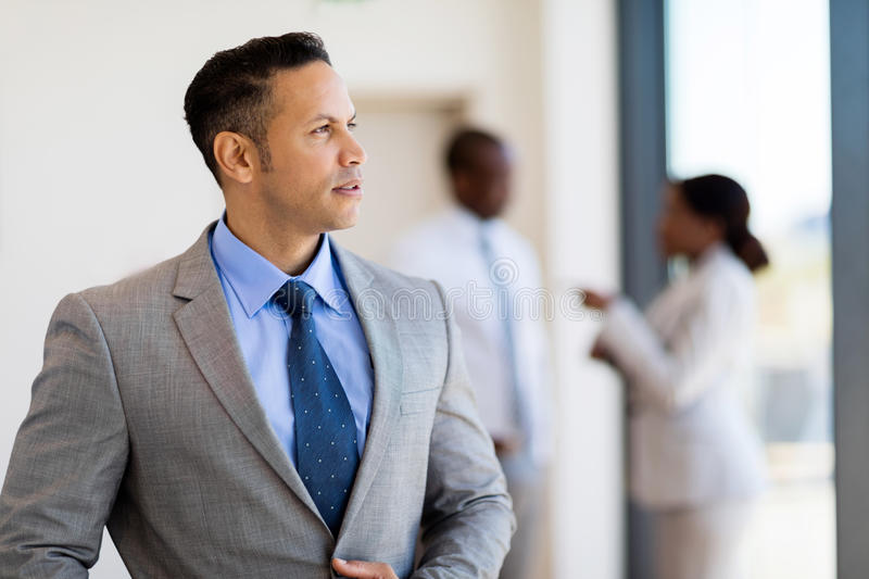 Thoughtful business man. Inside an office building royalty free stock photos