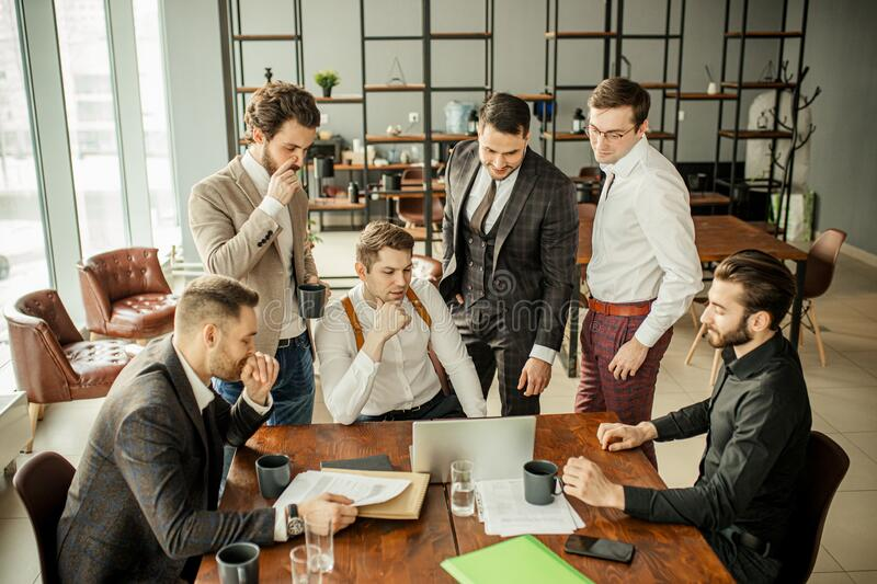 Thoughtful business people in office royalty free stock photo