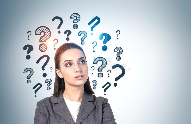 Thoughtful business woman, question marks stock image