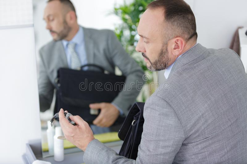 Thoughtful business working indoors. A thoughtful business working indoors royalty free stock photo