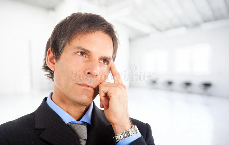 Thoughtful businessman stock image