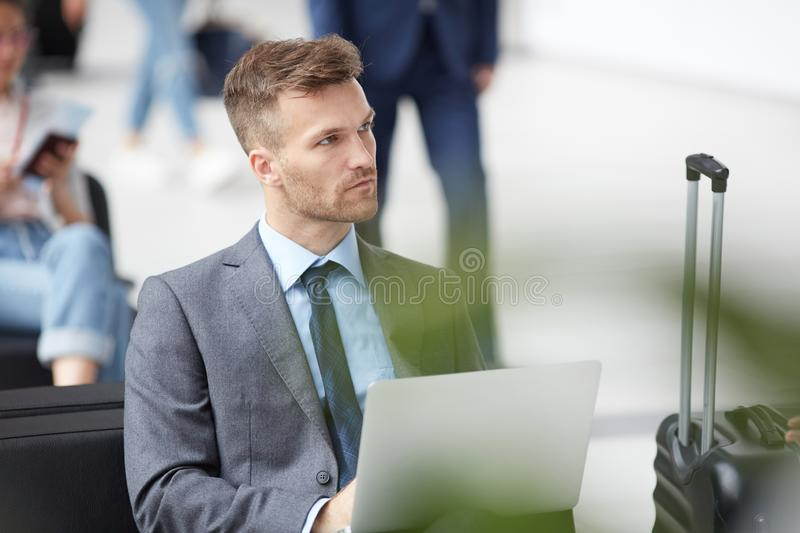 Thoughtful businessman in airport stock images