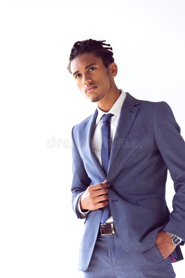 Thoughtful businessman in a blue suit with a hand in his pocket stock images