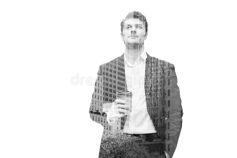 Thoughtful businessman holding cup with coffee and looking up royalty free stock photos
