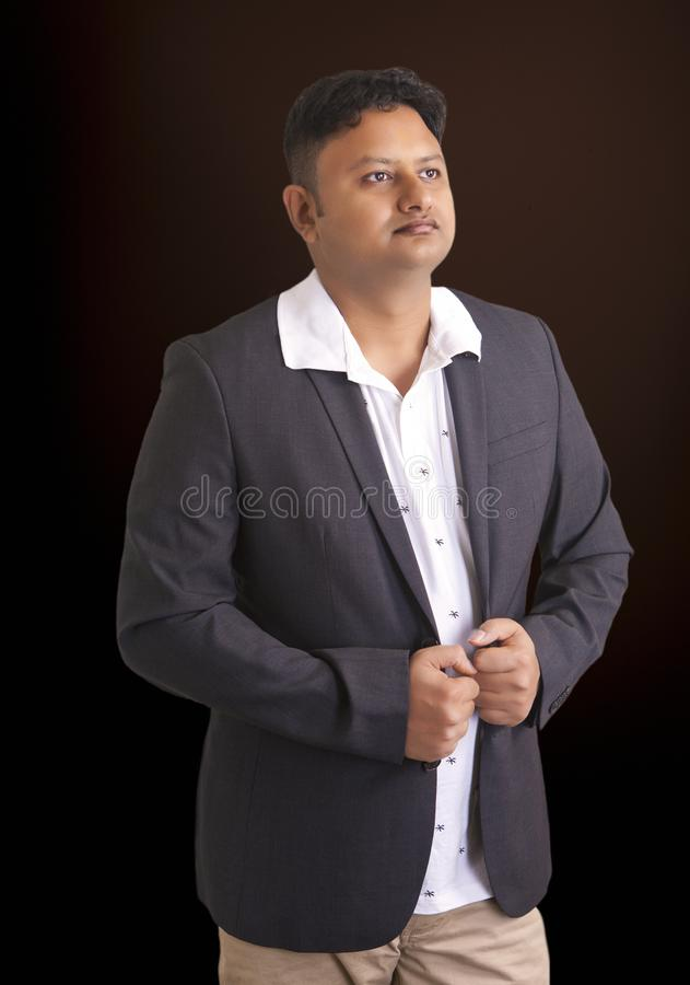 Thoughtful businessman, standing portrait on dark background royalty free stock photo