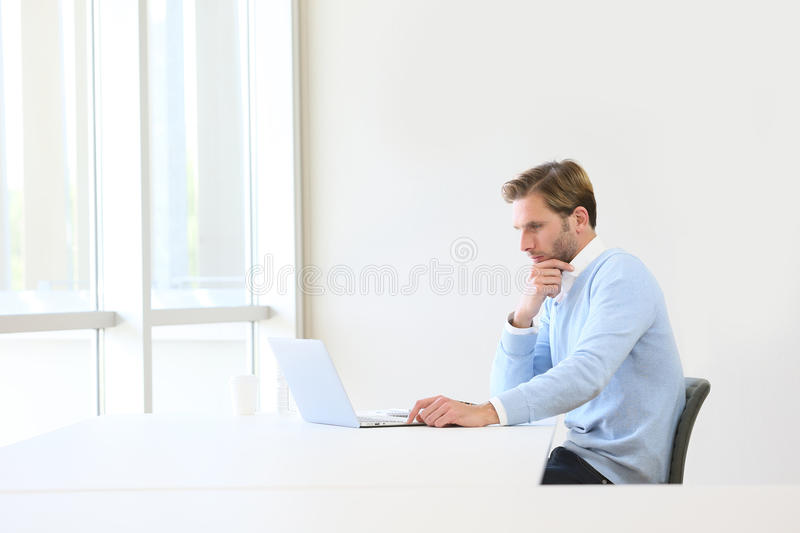 Thoughtful businessman on laptop royalty free stock photos