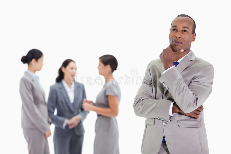 Download Thoughtful Businessman Looking Up With Co-workers Royalty Free Stock Images - Image: 23012519