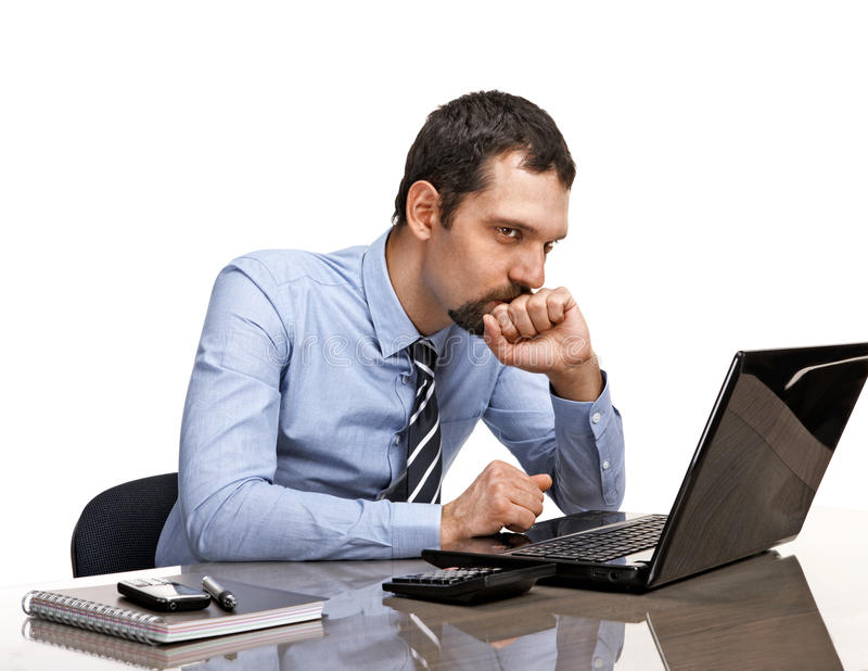 Download Thoughtful Businessman At Office Desk Looking On Laptop Isolated On White Background Stock Photo - Image: 32426070