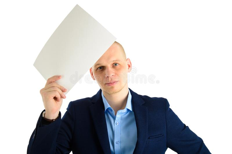 Thoughtful businessman in stylish suit holding empty sheet of paper over his forehead isolated on white background royalty free stock photo