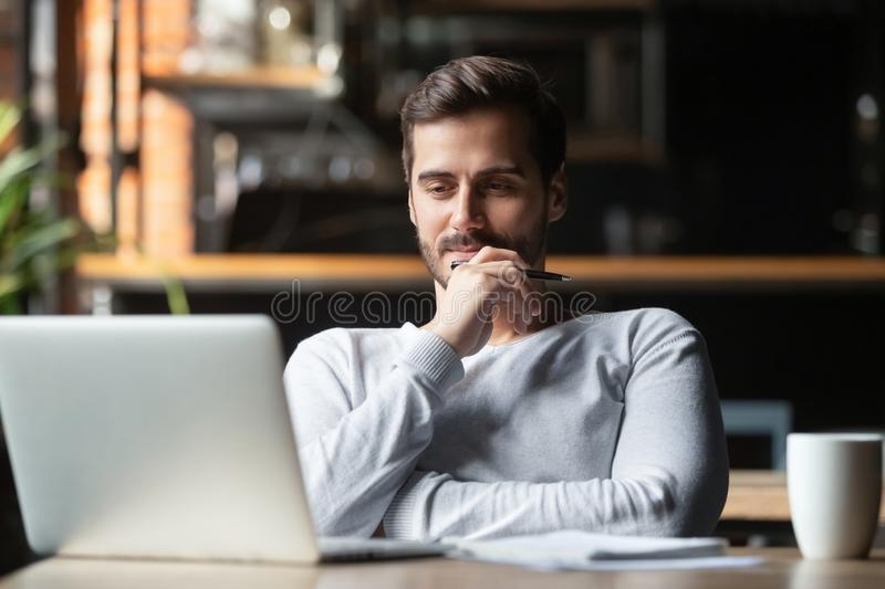Thoughtful businessman think of online project looking at laptop royalty free stock images