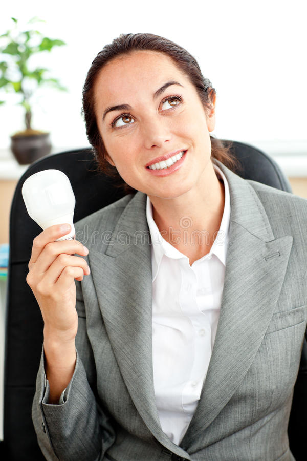 Thoughtful Businesswoman Holding A Light Bulb Royalty Free Stock Photos