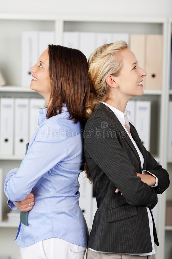 Download Thoughtful Businesswomen Standing Back To Back Stock Photo - Image: 31203532