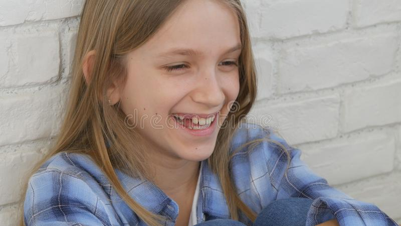 Thoughtful Child Portrait, Laughing Kid Face Looking in Camera Blonde Bored Girl stock photography