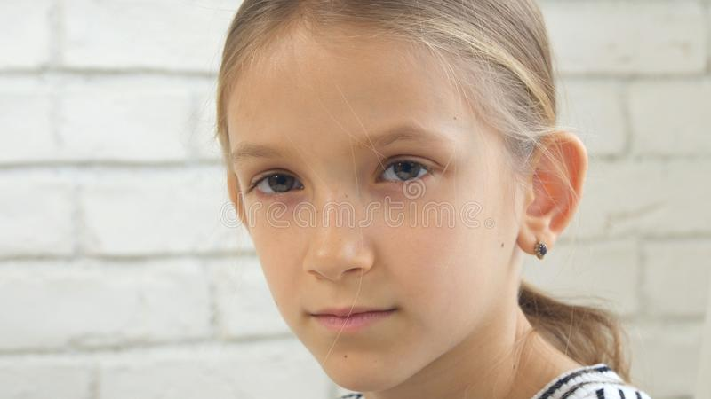 Thoughtful Child Portrait, Pensive Kid Face Looking in Camera, Blonde Bored Girl stock photos