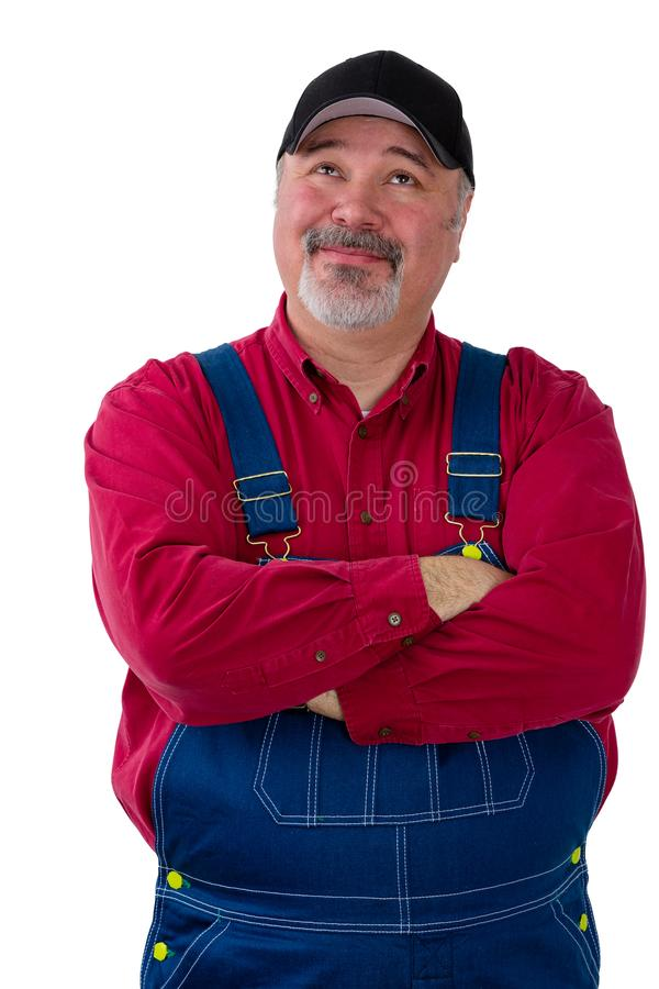 Thoughtful confident farmer or worker in dungarees stock photography