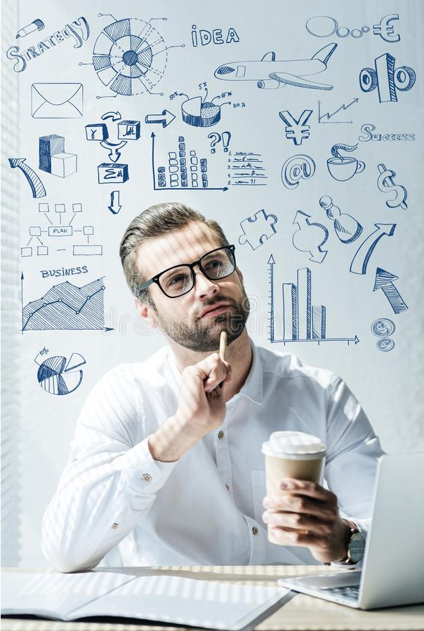 thoughtful developer sitting at workplace with SEO ideas stock photography