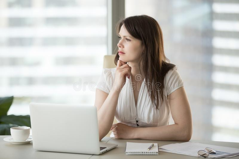 Thoughtful doubtful businesswoman looking away thinking of probl royalty free stock photo