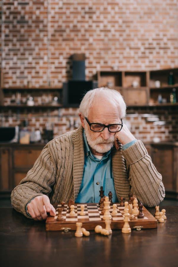 Thoughtful elder man stock photo