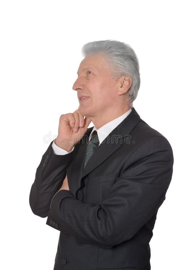 Thoughtful elderly man in suit royalty free stock photos