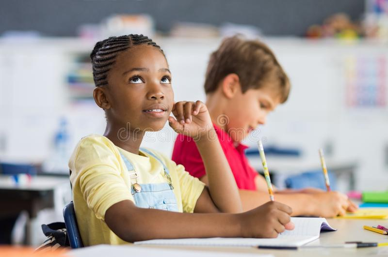 African girl thinking in class royalty free stock photo