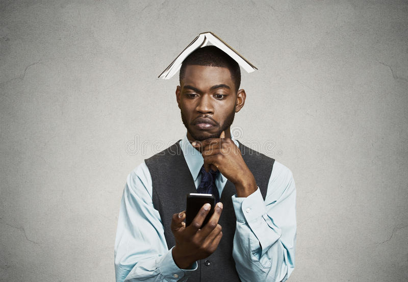 Thoughtful executive deciding what to reply on smart phone stock photography