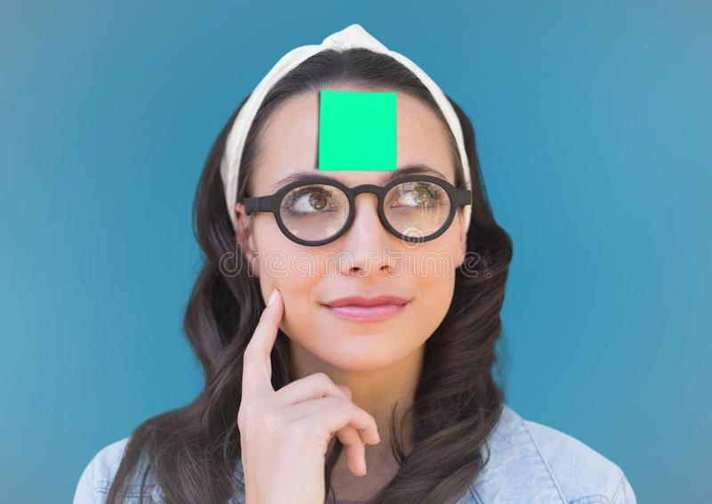 Thoughtful female executive with sticky note on head against blue background. Digital composite image of thoughtful female executive with sticky note on head stock illustration