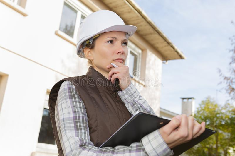 Thoughtful female health and safety inspector stock photography